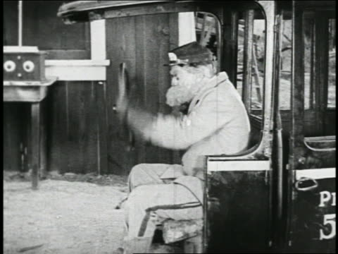 b/w 1923 bearded driver holding wheel of car + looking around / rest of car missing / feature - 35 39 jahre stock-videos und b-roll-filmmaterial