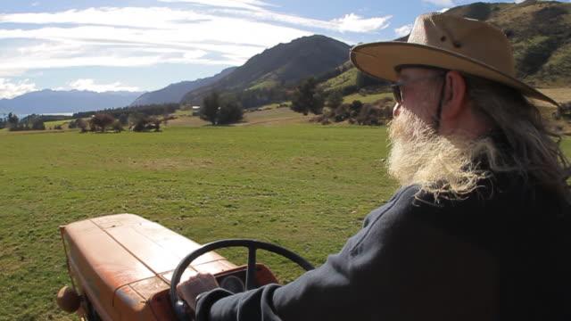 Bearded farmer on tractor