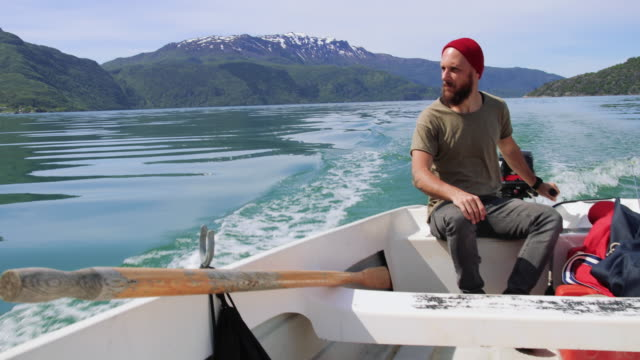 bearded fisherman on a small fishing boat: sailing in a fjord in norway - sailor stock videos & royalty-free footage