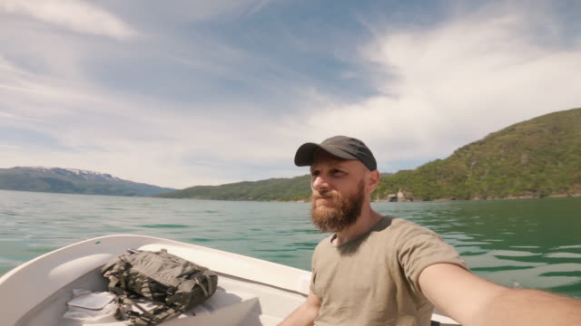 bearded fisherman on a small fishing boat: selfie in a fjord in norway - sailor stock videos & royalty-free footage