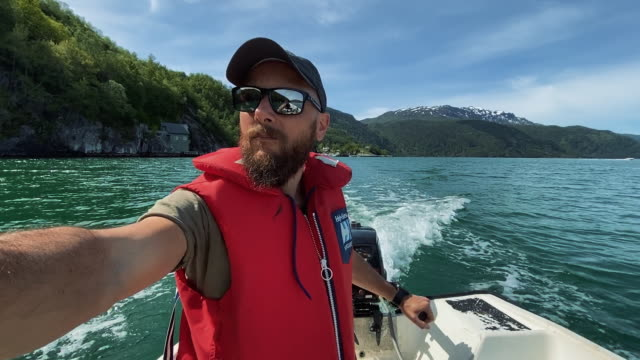 bearded fisherman on a small fishing boat: selfie in a fjord in norway - life jacket stock videos & royalty-free footage