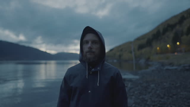 bearded fisherman portrait: with raincoat by a fjord at night - traditionally norwegian stock videos & royalty-free footage