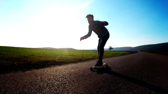 Bearded Hipster skateboarding on a nice  spring day