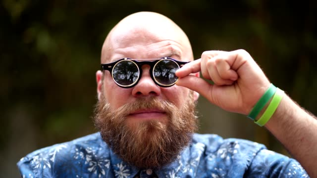bearded hipster with a cool sunglasses - pulling funny faces stock videos & royalty-free footage