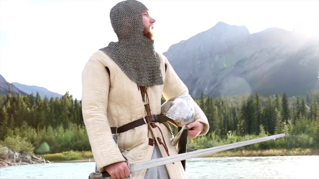 bearded man in medieval/viking costume pauses by river - viking stock videos and b-roll footage