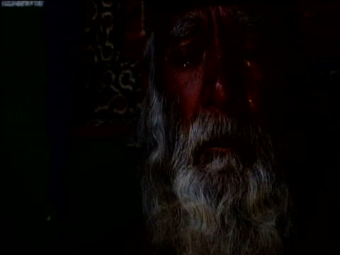 bearded man listens to religious music and shakes head with tears in his eyes afghanistan - religious music stock videos and b-roll footage