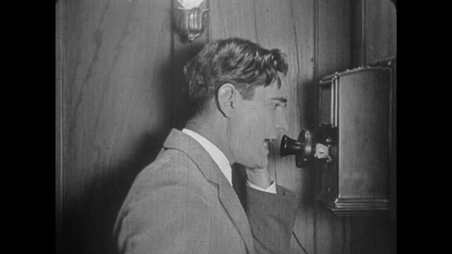 1925 bearded man reacts badly to news received by telephone - anno 1925 video stock e b–roll