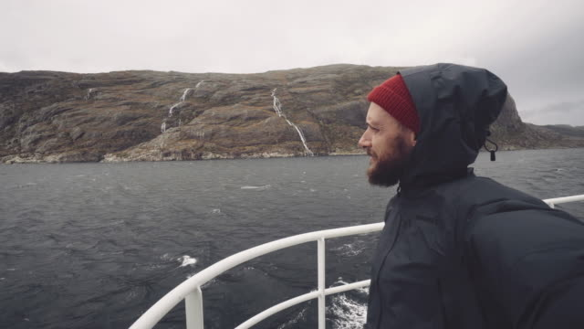 bearded man selfie on a sailing boat: in the fjords of norway - sailor stock videos & royalty-free footage