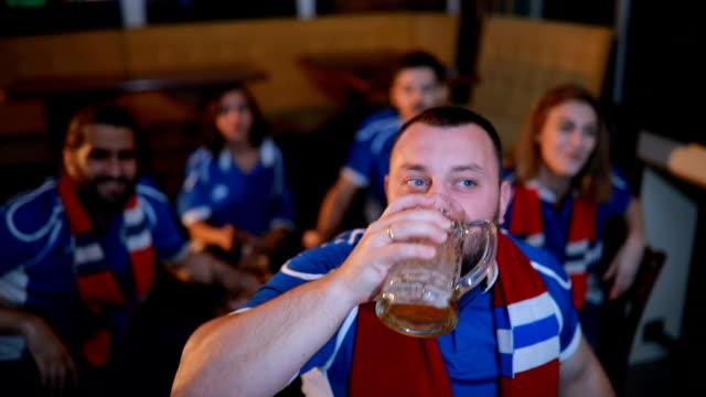 bearded man soccer fan - fan enthusiast stock videos and b-roll footage