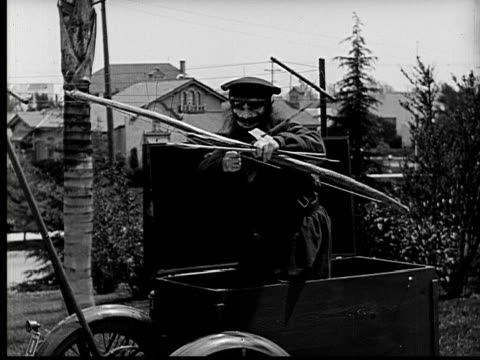 1924 b&w ms bearded man sticking out of box firing bow and arrow  - 1924 stock videos & royalty-free footage
