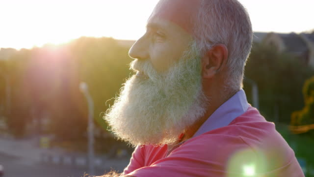 bearded senior man  looks into the distance and smiles - side view stock videos & royalty-free footage