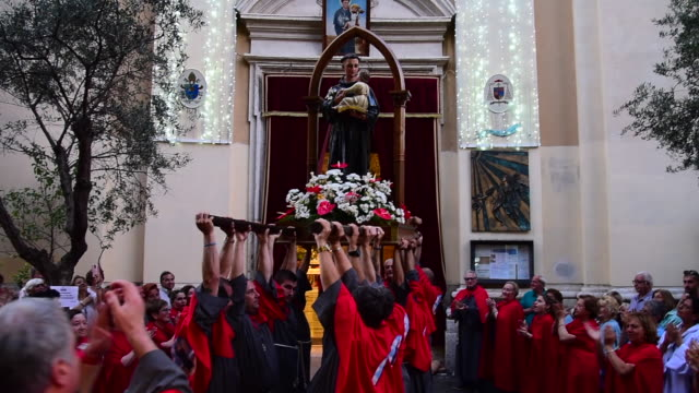 Bearers carry the relic and the statue in honor of St Anthony of Padua from the Church of St Dorothy of the Friars Minor Conventual for the...