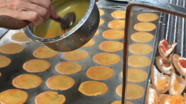 beat egg for thai crispy pancake ,bangkok , thailand - crunchy stock videos & royalty-free footage