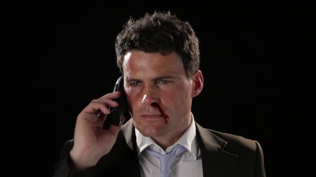 vidéos et rushes de cu, tu, beaten businessman dialing and then using phone - téléphone sans fil