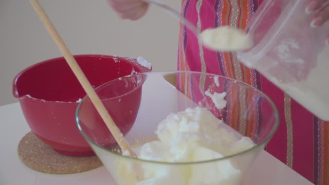 beaten egg white and yolk in bowl - egg yolk stock videos & royalty-free footage