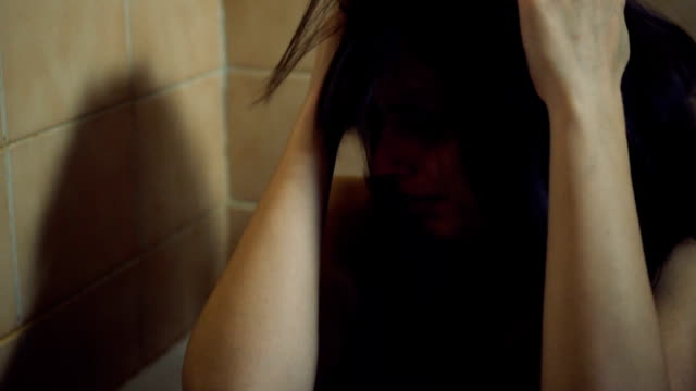 beaten young woman - torture stock videos & royalty-free footage
