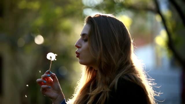 beatiful girl blow a dandelion - lips stock videos & royalty-free footage