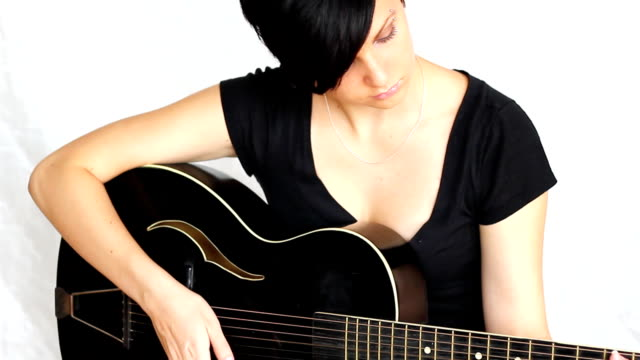 beatiful girl playing acoustic guitar. - country and western stock videos & royalty-free footage