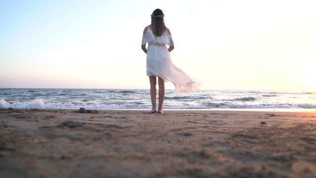 beatiful pregnant woman with white dress on the beach - maternity wear stock videos & royalty-free footage