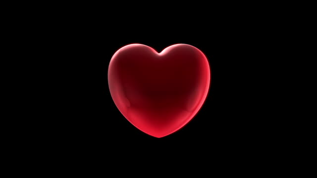 beating heart on black background - pulsating stock videos & royalty-free footage