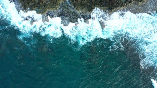 beating wave on the rock with splash - okinawa prefecture stock videos & royalty-free footage