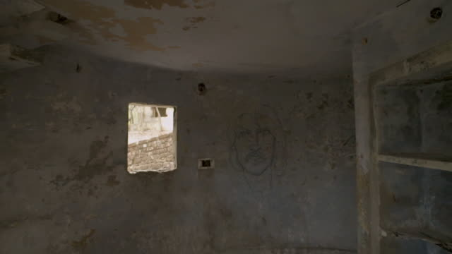 w/s steadycam beatles ashram, george harrison portrait painted in a wall - george harrison stock videos & royalty-free footage