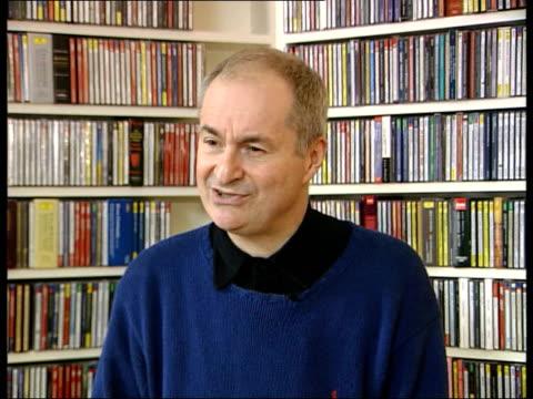vídeos de stock, filmes e b-roll de beatles autobiography to be released int paul gambaccini interview sot talks of beatles autobiography - biografia