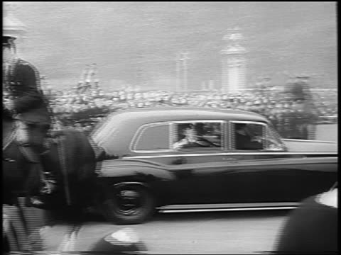 beatles in limousine exiting buckingham palace gate past crowds of teens / london - paul mccartney stock videos and b-roll footage