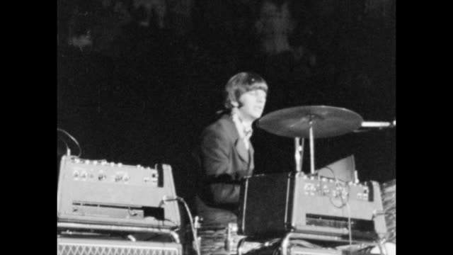 beatles playing on stage at the at the maple leaf gardens, one of the stops of their last ever concert tour. - the beatles bildbanksvideor och videomaterial från bakom kulisserna