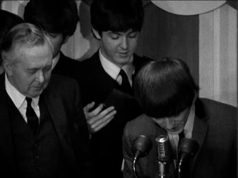 beatles receive showbiz awards from pm harold wilson ***contains london dorchester hotel harold wilson presents the 'the beatles' with silver heart... - harold wilson stock-videos und b-roll-filmmaterial