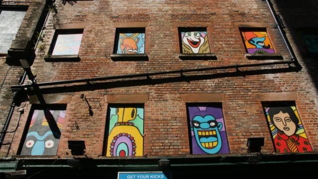 beatles themed window murals on mathew street, liverpool - the beatles stock videos & royalty-free footage