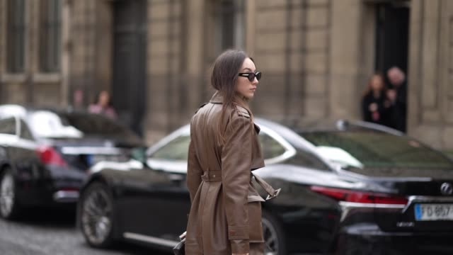 beatrice gutu wears sunglasses a brown leather jacket a white vneck tshirt brown leather shorts quilted sandals a bottega veneta bag outside... - v neck stock videos & royalty-free footage