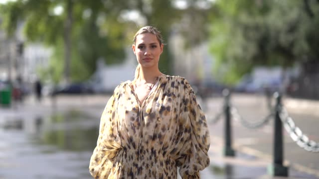 beatrice valli wears a vneck beige and brown spotted gathered and flowing mini dress with long sleeves brown pointy heeled ankleboots outside... - v neck stock videos & royalty-free footage