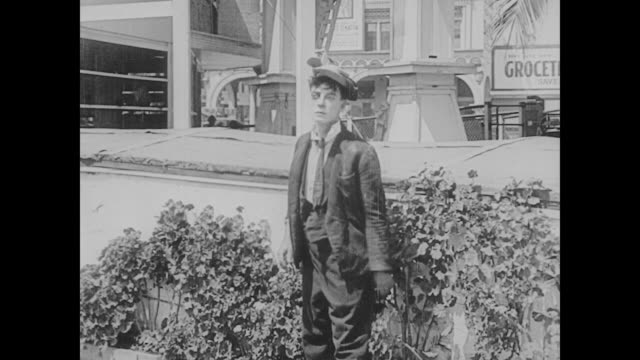 1923 a beat-up man (buster keaton) staggers away - 1923 stock videos & royalty-free footage