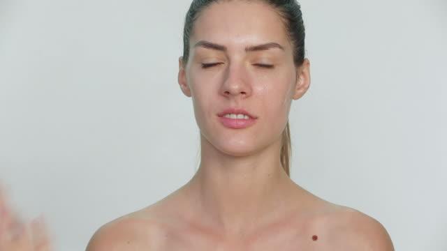 Beautician applying peel off mask