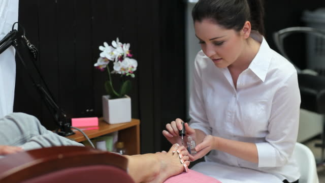 beautician painting nails - painting toenails stock videos & royalty-free footage
