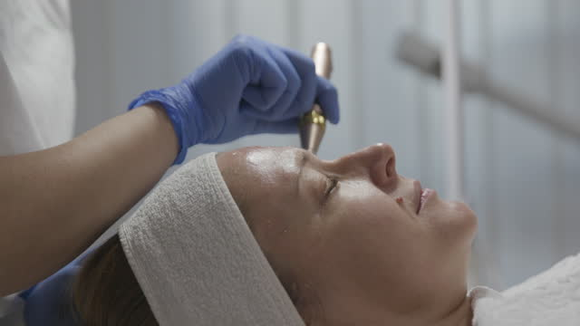 beautician performing a needle mesotherapy treatment on a woman's face, close up - beauty treatment stock videos & royalty-free footage
