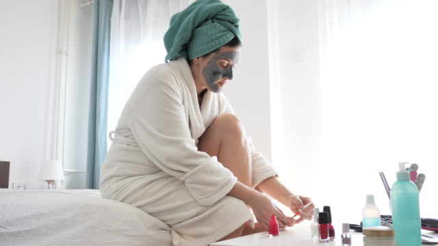 beautification at home - woman polishing her nails - pedicure stock videos & royalty-free footage