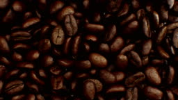 Beautiful Abstract Roasted Coffee Beans Fall Down and Fill the Screen Making Transition Close-up in Slow Motion on Green Screen. 3d Animation with Alpha Matte.