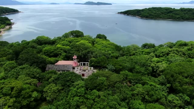 beautiful aerial cinematic view of the san lucas island national park in costa rica - costa rica stock videos & royalty-free footage