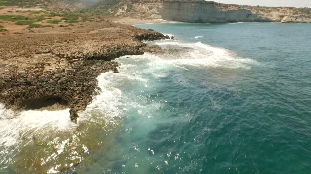 Beautiful aerial / drone shot along the coast of Cyprus on a sunny day