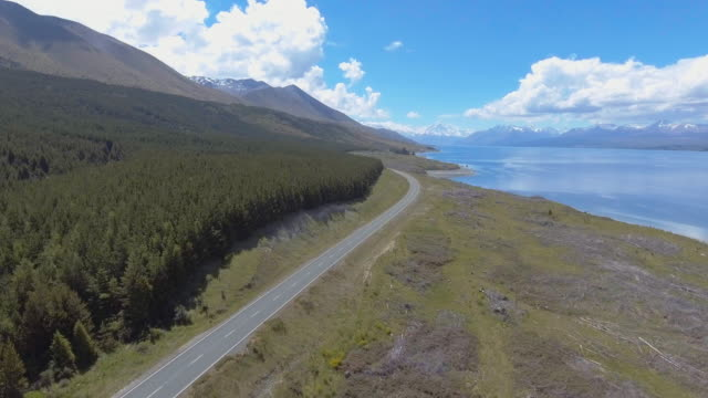Beautiful aerial drone shot of a car at lake in the mountain