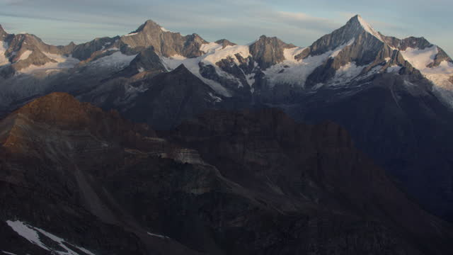 beautiful aerial view over a large glacier on the way to matterhorn mountain, one of the tallest mountains in europe - snowcapped mountain stock videos & royalty-free footage