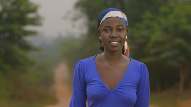 beautiful africa, portrait of a young african woman smiling modestly - ghana stock videos & royalty-free footage