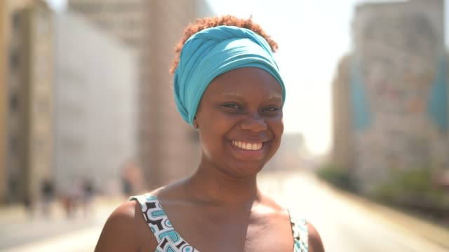 beautiful african ethnicity woman portrait at minhocao, sao paulo, brazil - headscarf stock videos & royalty-free footage