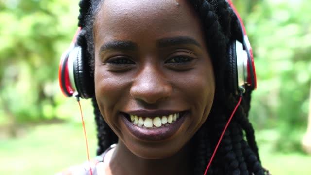 beautiful african woman portrait at park - pardo brazilian stock videos & royalty-free footage
