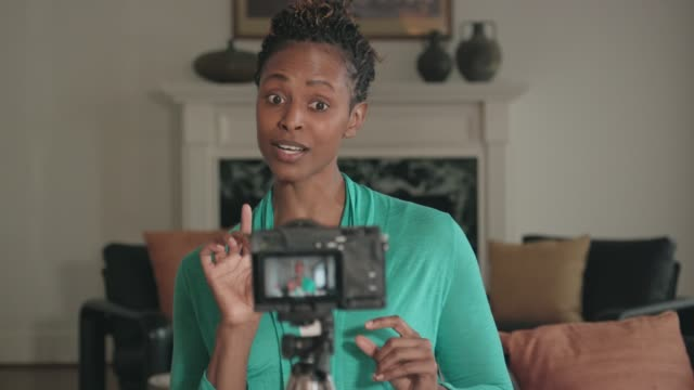 Beautiful African-American Vlogger Recording a Show
