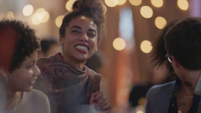 a beautiful african-american woman leads her friends into a bar and calls to the bartender - curly stock videos & royalty-free footage