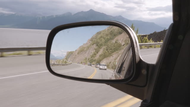 uhd 4k: beautiful alaskan landscape in the rearview mirror of a vehicle - two lane highway stock videos & royalty-free footage