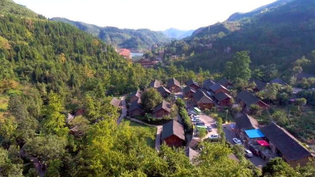 Beautiful Ancient Village in Colorful Valley in Autumn, Guizhou Province, China. Aerial video